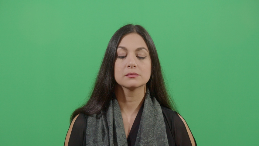 Up And Down Eyes Movement Of A Woman Like Reading Very Fast Or Chasing An Object. Studio Isolated Shot Against Green Screen Background | Shutterstock HD Video #1039151009