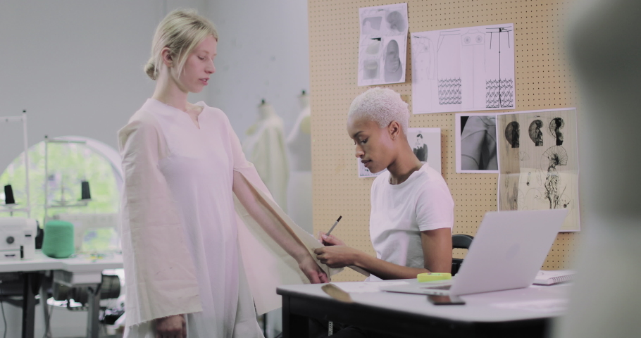 Fashion designer working on design with a model | Shutterstock HD Video #1039186019