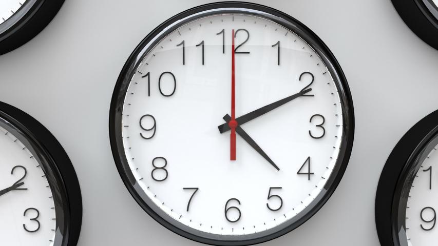 Clocks running fast. Multiple wall clocks in white background spinning fast. | Shutterstock HD Video #1040130689