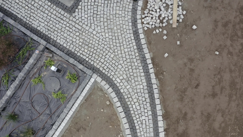 Residential Granite Brick Paving by Caucasian Construction Industry Worker. Aerial Footage. | Shutterstock HD Video #1040290169
