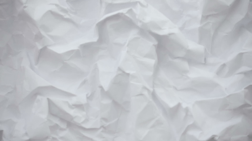 Crumpled sheet of paper. Live wallpaper abstract background. Slow motion. Place for text, title | Shutterstock HD Video #1040398499