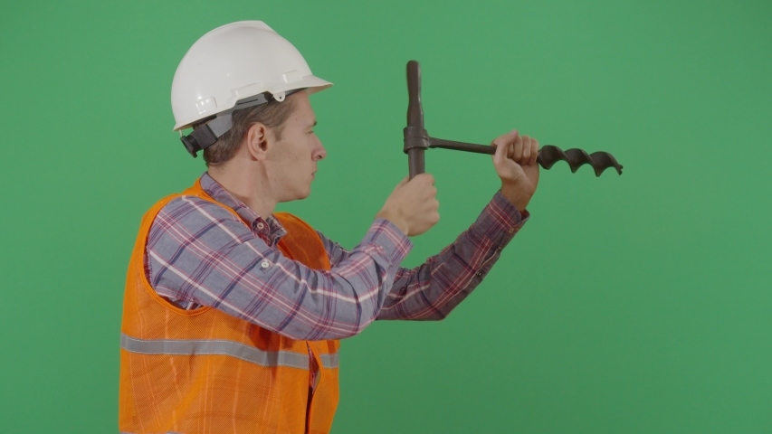 Adult Man Engineer Drilling The Green Screen. Studio Isolated Shot Against Green Screen Background | Shutterstock HD Video #1040502269