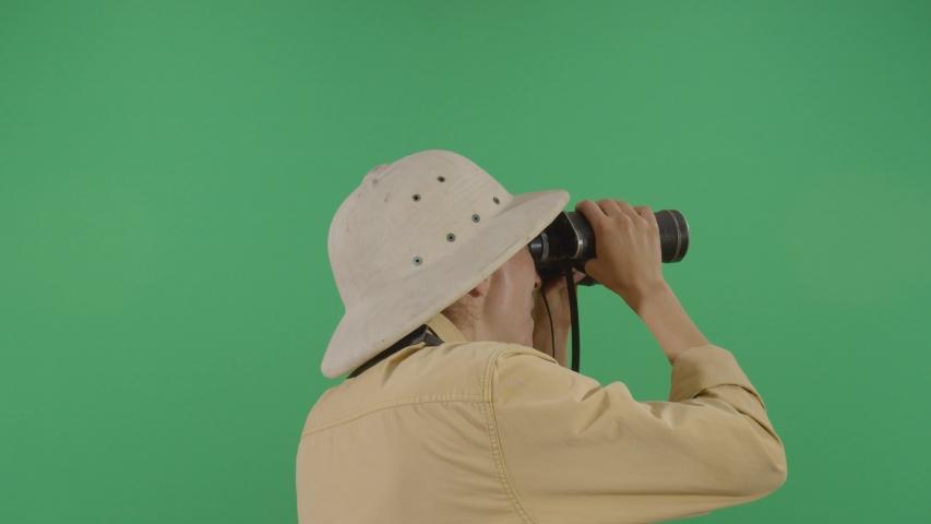 Woman Explorer Watching Through Binoculars To The Green Screen . Studio Isolated Shot Against Green Screen Background | Shutterstock HD Video #1040503199