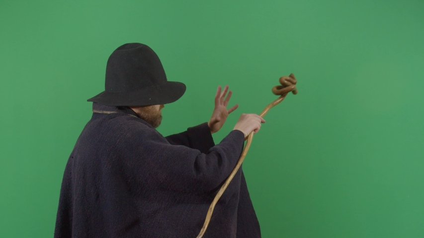 Adult Man Magician Opening A Portal On The Green Screen. Studio Isolated Shot Against Green Screen Background | Shutterstock HD Video #1040503379