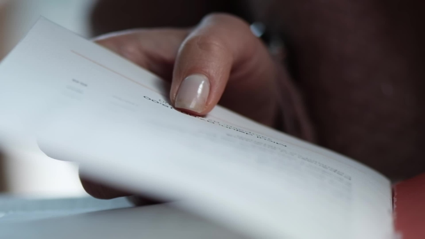 Woman hands listing a restaurant menu, close up | Shutterstock HD Video #1040908679