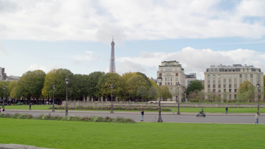 The Eiffel Tower in Paris by drone from the Invalides area with the Seine river and La Defense business center  | Shutterstock HD Video #1040988539