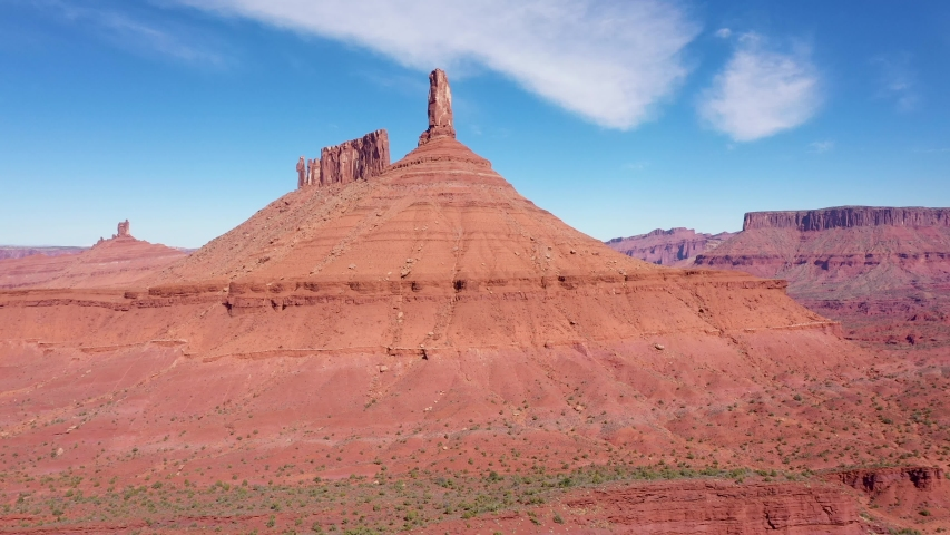 High monuments of red orange rocks butte of canyon in valley of Colorado river in Western Usa. Fantastic landscape of desert nature and sandstone erosion. Aerial motion up | Shutterstock HD Video #1041041249