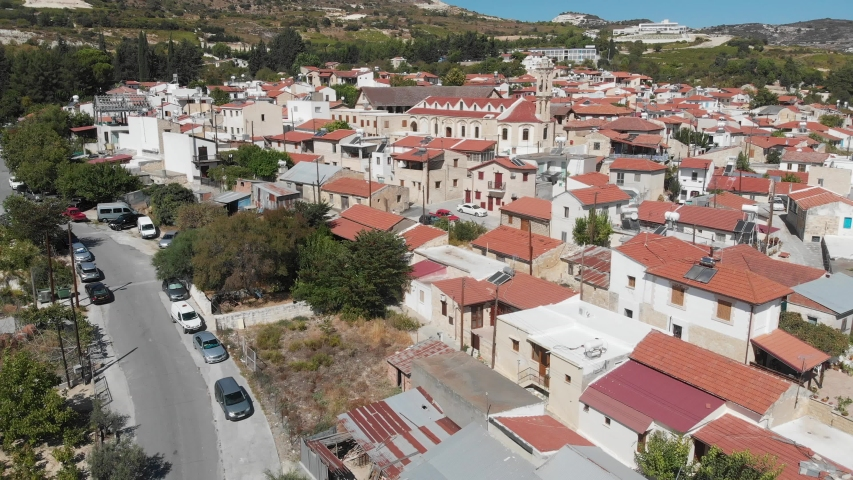 Panorama of the village of Omodos, (Cyprus) with Monastery of the Holy Cross (The Monastery of Timios and Zoopoi Stavros). Videography from a drone. | Shutterstock HD Video #1041078499