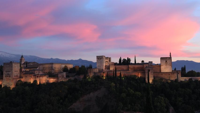 Beautiful view sunset sky scene at Ancient arabic fortress Alhambra, Granada, Spain, European travel landmark | Shutterstock HD Video #1041080479