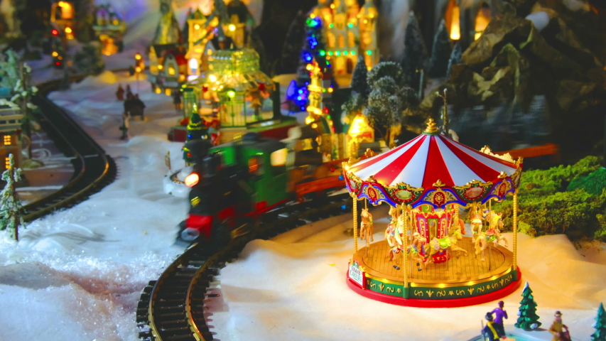 Vintage toy store with carousel train and balloon in white snow christmas set . | Shutterstock HD Video #1041092779