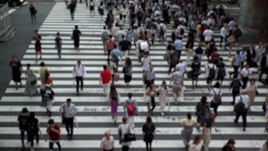 UMEDA, OSAKA, JAPAN - CIRCA SEPTEMBER 2019 : Aerial blurred high angle view of zebra crossing near Osaka train station. Crowd of people at the street. Shot in busy rush hour. Wide slow motion. | Shutterstock HD Video #1041098719