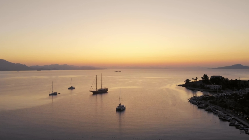 Anchored sailing ships in Datca harbor and a great sunrise. Aerial shots | Shutterstock HD Video #1041417439