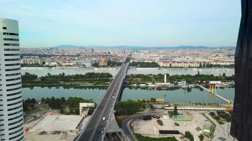 Vienna, Austria. Aerial top view of the  beautiful river and the St. Francis of Assisi Church. Drone flying from city buildings through river with bridges to church. Taken by drone at bright day  | Shutterstock HD Video #1041418519