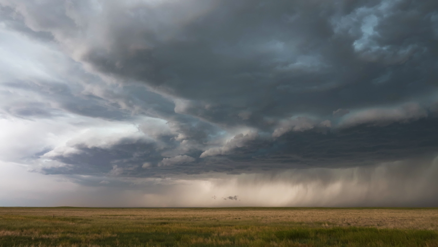 Clouds moving in time lapse bringing dramatic storm as it moves over the plains. | Shutterstock HD Video #1041578749