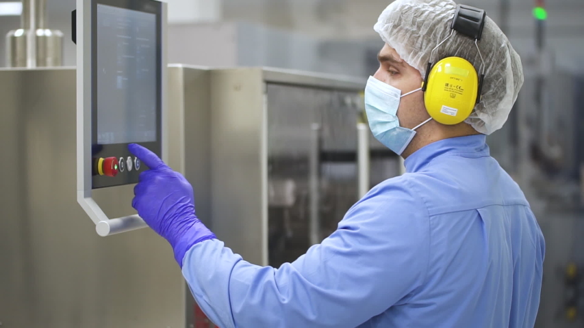 Man laboratory worker work with computer in interior of pharmaceutical factory. Side view of american male employee watching and touching pc screen, control production process in medical plant   Shutterstock HD Video #1041766489