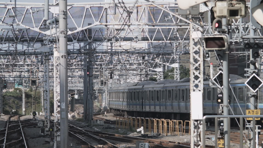 Tokyo , Kantõ / Japan - 09 25 2015: Footage of train passing thru big railway station medium wide shot | Shutterstock HD Video #1041837139
