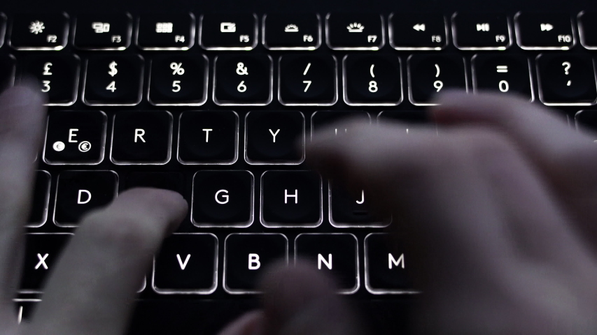Hands typing the word Hello and Hi on a dark backlit keyboard. | Shutterstock HD Video #1042109329