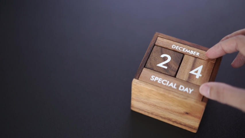 Day and month of special day of year fill into wooden cube calendar, copy space on left | Shutterstock HD Video #1042247929