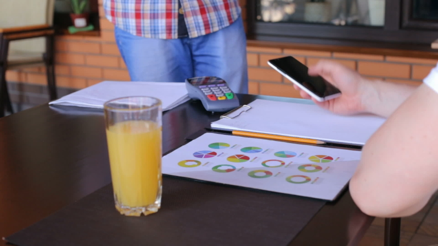Young businessman pays using NFC wireless system in a restaurant   Shutterstock HD Video #1042270189
