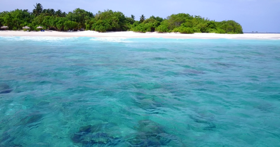 Exotic small island with palm trees and white sand beaches in crystal clear waters of Gulf of Siam | Shutterstock HD Video #1042319659