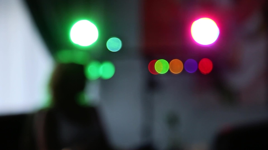 People dancing at party. Unrecognizable silhouette crowd in nightclub with disco light.  soft focus   Shutterstock HD Video #1042346209