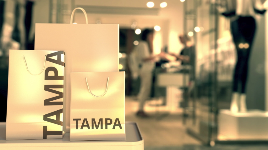 Paper bags with Tampa text. Shopping in the United States related conceptual 3D animation | Shutterstock HD Video #1042481359