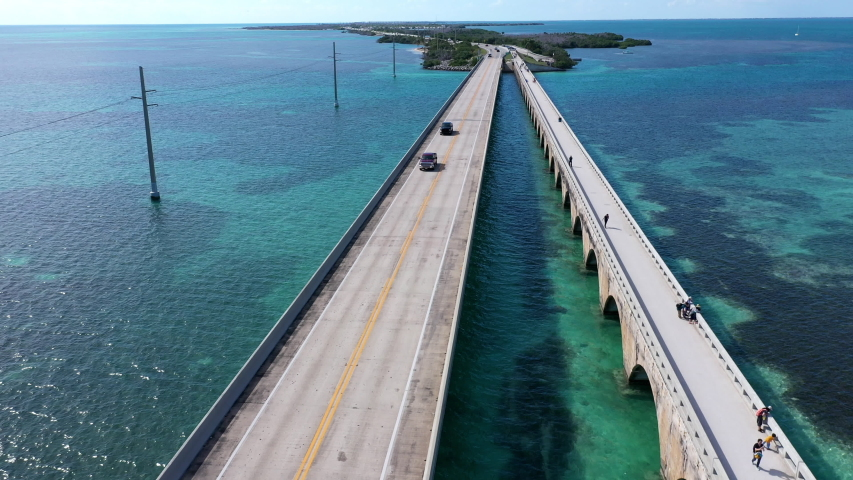 Aerial shot of the Seven Mile Bridge in Florida which connects several of the Florida Keys on the way to Key West | Shutterstock HD Video #1042489669