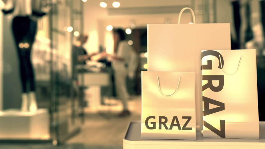 Bags with Graz text. Shopping in Austria related conceptual 3D animation | Shutterstock HD Video #1042569649