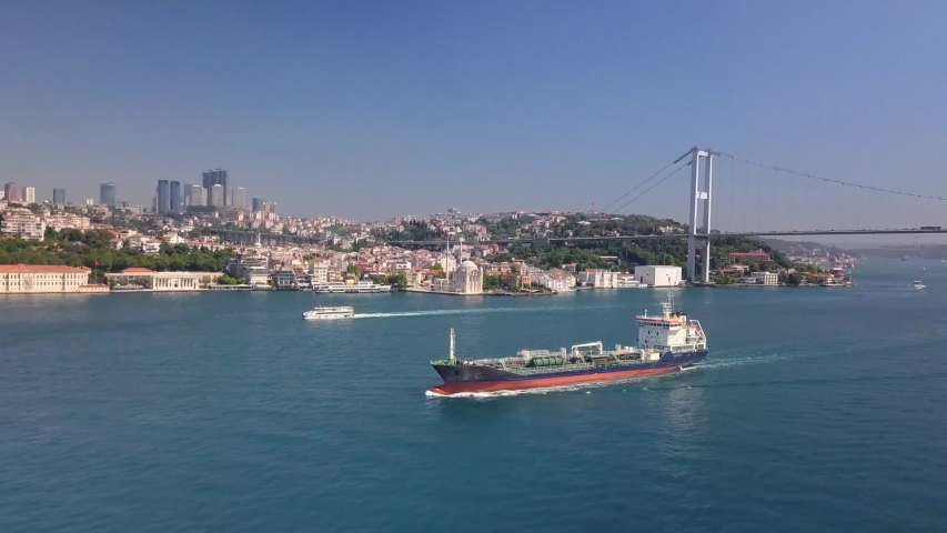 Oil chemical tanker sailing along the Bosporus shore in Istanbul City. Aerial. Oil Tanker traffic is getting denser as the need for the transportation of Asian and Caucasian petroleum increases  | Shutterstock HD Video #1042727029