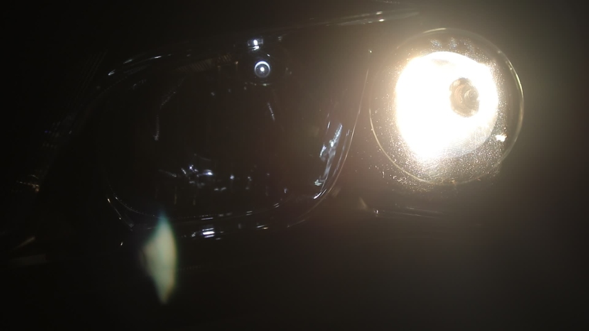 Turn on the car headlights Move from right to left | Shutterstock HD Video #1042788889