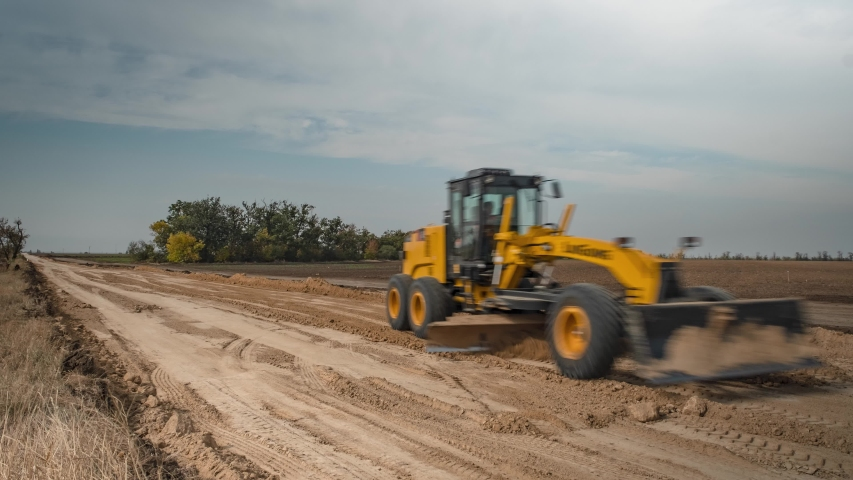 Grader leveles the road. Work machinery. Faster shooting. Time Lapse. | Shutterstock HD Video #1042793419