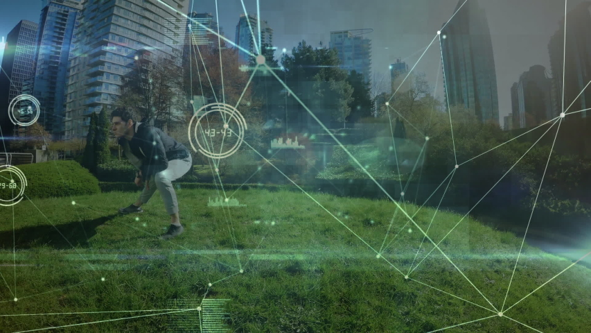 Animation of data processing and network of connections with a young Caucasian man stretching in an urban park in the background | Shutterstock HD Video #1042801999