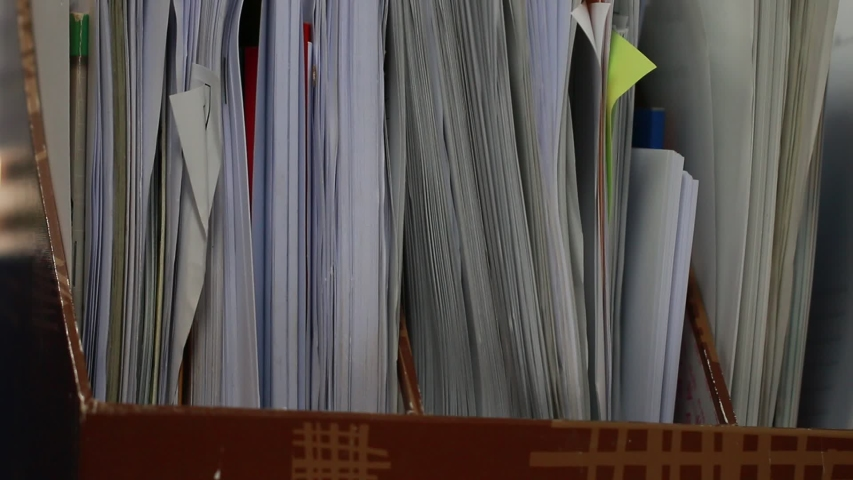 Piled paperwork for recycle documents folders, Stack business paper on desk messy in office. Old junk document achieves in print folder doc forms, use recycling for save. Business file sheet concept | Shutterstock HD Video #1043002549