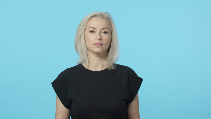 Slow-motion pretty caucasian blond adult woman speaking to coworker, agree with person during conversation, nod in agreement, say yes, yeah, impressed with well done job, praise teamwork