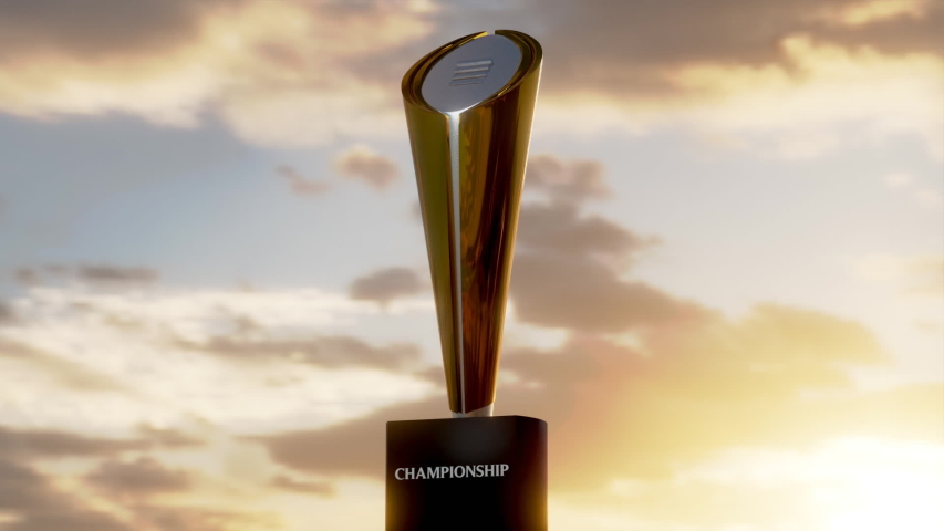 Low sweeping shot of college football playoff trophy with beautiful sunset sky. Realistic 3D Animation. Cinematic | Shutterstock HD Video #1044445189