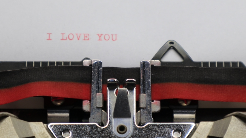 Typing I LOVE YOU with an old vintage Typewriter   Shutterstock HD Video #1044786139