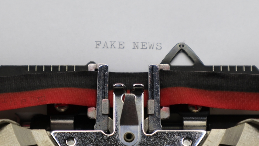 Typing FAKE NEWS with an old vintage Typewriter   Shutterstock HD Video #1044790819