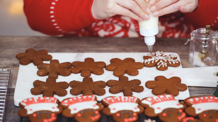 Step by step. Decorating gingerbread cookies with royal icing.   Shutterstock HD Video #1044885589