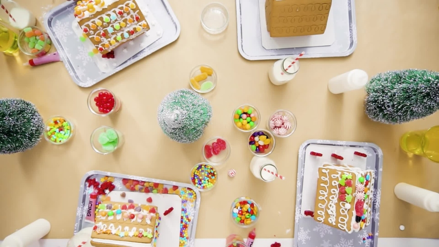 Flat lay. Step by step. Kids decorating small gingerbread houses at the Christmas craft party.   Shutterstock HD Video #1044886159