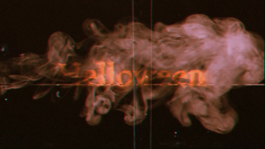 The word Halloween appearing on the screen with a smoke, typical of a horror flick. VHS 4k video. | Shutterstock HD Video #1044941659
