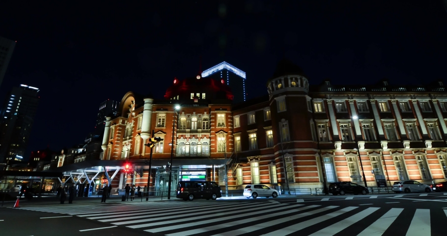Night time zoom out Timelapse in front of Tokyo Station with some traffic and many people.Tokyo Crossing road to Tokyo Station in night time.Famous tourist attraction in Tokyo. | Shutterstock HD Video #1045006219