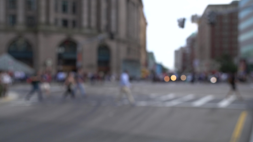 Blurred commuters passing in rush hour evening at downtown in Boston | Shutterstock HD Video #1045008739