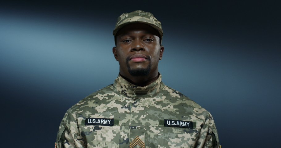 Portrait shot of the handsome strong African American soldier of USA smiling cheerfully to the camera. Close up. | Shutterstock HD Video #1045021699