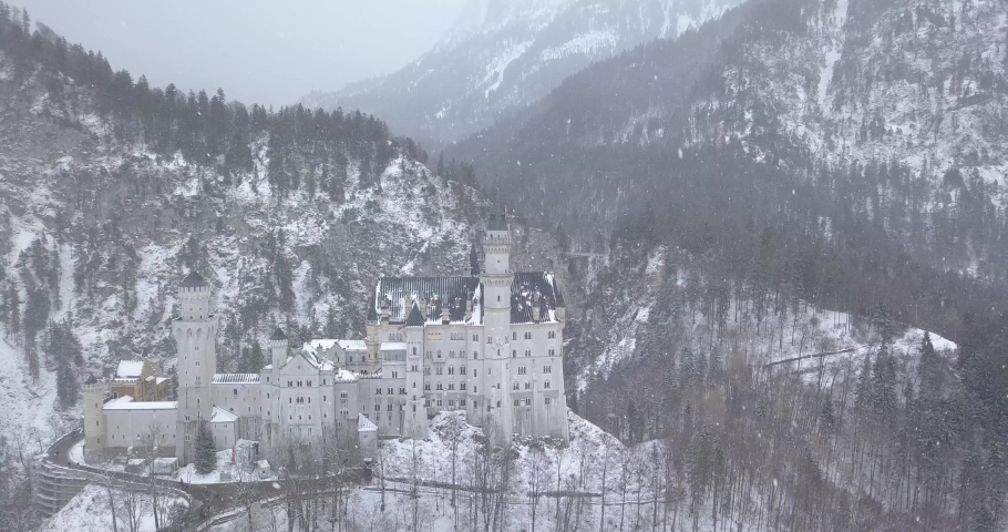 Neuschwanstein Castle in Winter Day . Mountains and Rocks. Bavarian Alps, Germany. Aerial View. Wide Shot. Drone is Orbiting Clockwise | Shutterstock HD Video #1045193239