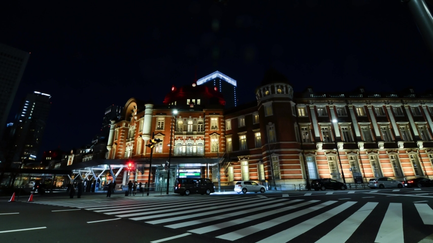 Night time Timelapse in front of Tokyo Station with some traffic and many people.Tokyo Crossing road to Tokyo Station in night time.Famous tourist attraction in Tokyo. | Shutterstock HD Video #1045199089