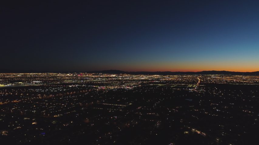 Las Vegas Cityscape at Sunrise. Morning Twilight. Mountains on Background. Nevada, USA. Aerial View. Drone Flies Forward | Shutterstock HD Video #1045236109