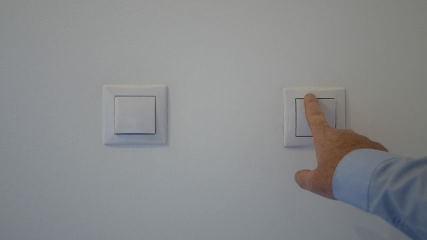Man Shutting Off the Light in the Office from the Switch on the Wall, Open and Close Light in the Room   Shutterstock HD Video #1045429459