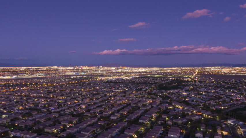 Las Vegas Skyline in Evening Twilight. Nevada, USA. Aerial Hyper Lapse, Time Lapse. Drone Flies Sideways   Shutterstock HD Video #1045719049