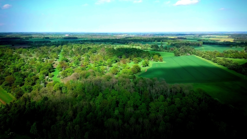 Drone flyby of woodland near Little Bytham and Scottlethorpe with views of Grimsthorpe Castle & Edenham. | Shutterstock HD Video #1046438419