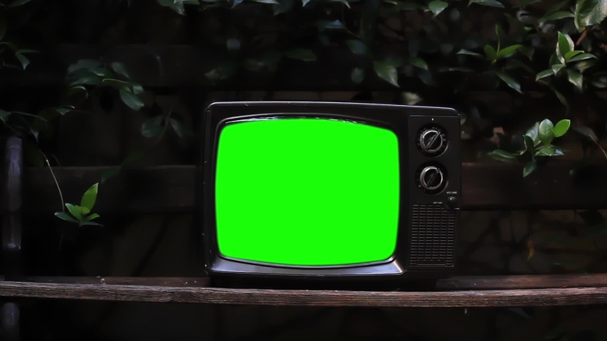 """Vintage TV over a Wood Bench Outdoor. Zoom In. You can Replace Green Screen with the Footage or Picture you Want with """"Keying"""" effect in After Effects (check out tutorials on YouTube). 
